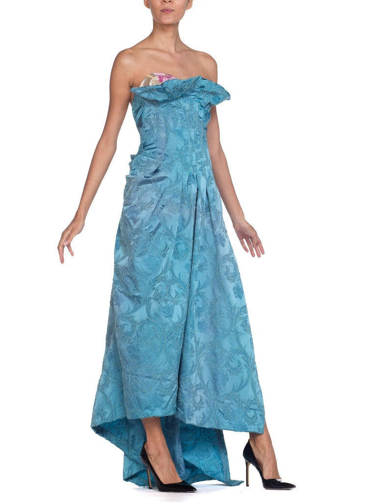Made from upcycled fabrics from the 1950s & 1940s so there are some areas of slight fading to the fabrics but this is seen as a sign of their age and beauty, adding to the askew beauty of this gown.  MORPHEW COLLECTION Aquamarine Blue Rayon & Silk