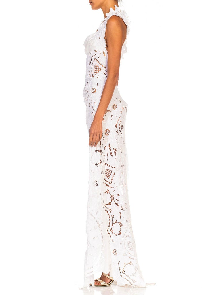 Made from textiles which are over 70 years old, so small holes and areas of repairs are there to tell the story of age and are not to be looked upon as flaws. MORPHEW COLLECTION White Linen Entirely Hand Embroidered Cut-Out Lace Gown