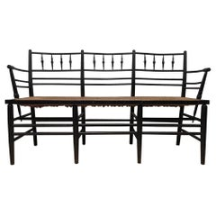 Morris & Co. an Arts & Crafts Museum Quality Ebonised Sussex Three-Seat Settee