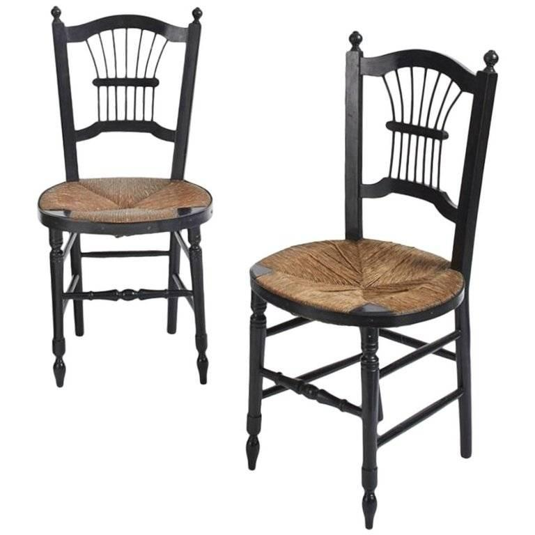 Morris and Co. a single ebonised rush-seat Sussex side chair designed by Daniel Gabriel Rossetti in original condition with original rush. We are happy to have the seat re rushed and restored if required. The one on the left has now sold.