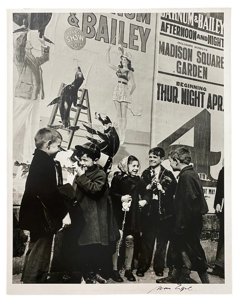 Kids with Circus Poster, NYC - Modern Photograph by Morris Engel