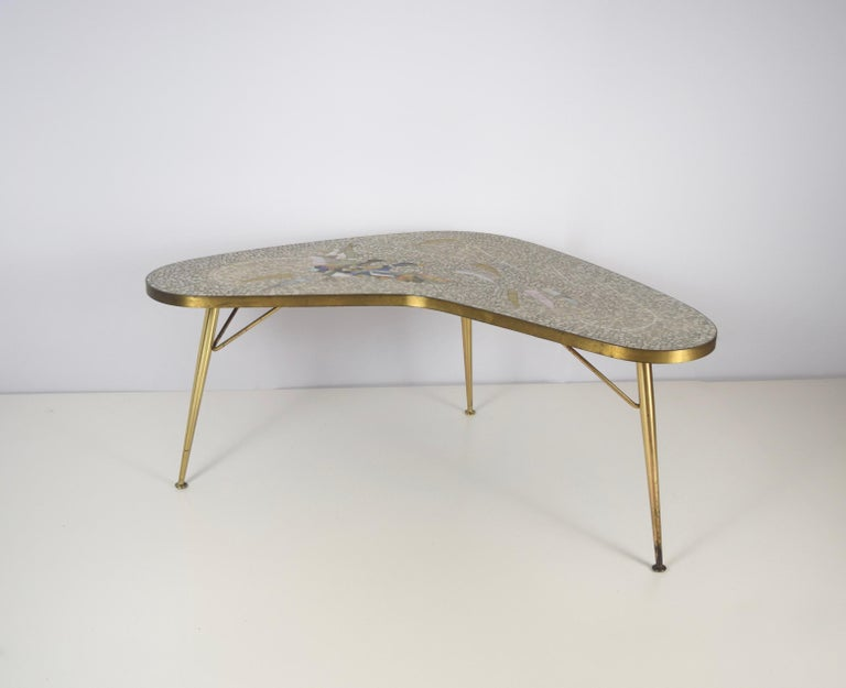 Stunning Mosaic and Brass Coffee Table by Berthold Müller-Oerlinghausen from Germany 1950s. This boomerang shaped table is in excellent condition. The mosaic pictures two ducks and has a very modern color palette. The brass is very shiny and gives