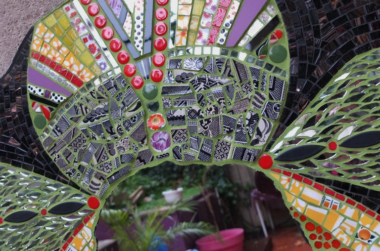 One of a kind mosaic mirror, created by the artist using an original vintage small customized covered in fragments of ceramic, porcelain dishes, old China, mirrors, glass, etc. All these different materials are gather together and hand cut one by