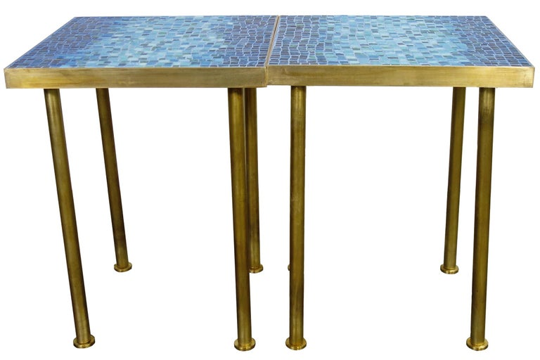 For your consideration is this incredible pair of smalti glass mosaic side tables on a solid brass frame. Wonderful shades of blue will highlight your space with a mid-century aesthetic that can match any decor. .