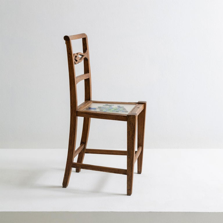 The Mosaiced chair is part of the mosaiced furniture collection that finds its inspiration in the element 'water'. It's made of restored chair from 1790, which belong to the style of Louis XVI. The chair is lightened through the sitting made of a