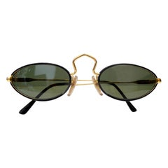 Moschino 1990s Persol Small Oval Sunglasses
