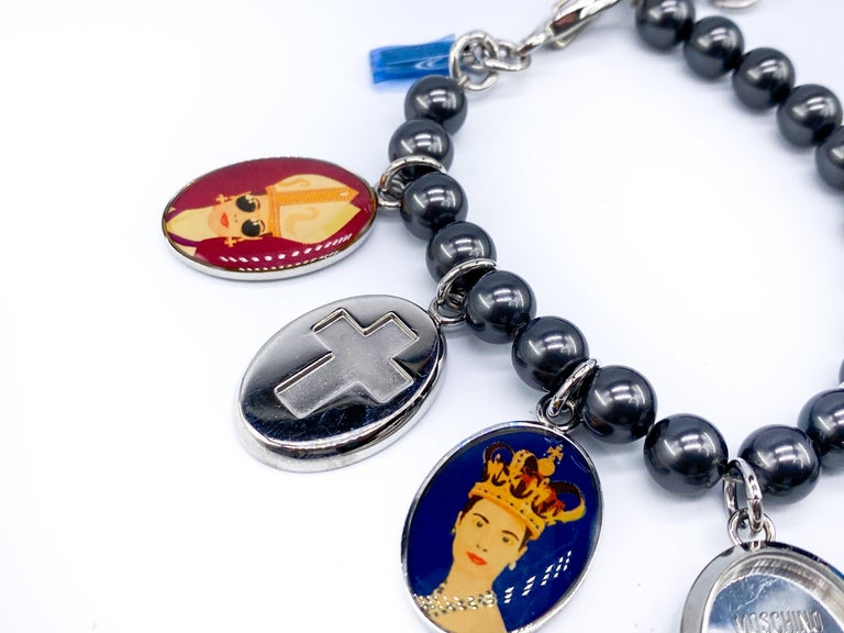 Moschino Vintage Statement Charm Bracelet  Amazing Moschino charm bracelet from the early 2000s.   Features various charms with Holy icons. One of the charms is a watch  Excellent condition aside from a few storage marks it looks unworn and still