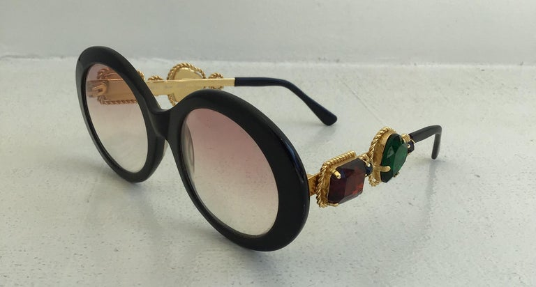Moschino By Persol Vintage M253 Jewelled Sunglasses. Gradient lenses adorned with auburn and green colored jewels. Same model worn by Lady Gaga.