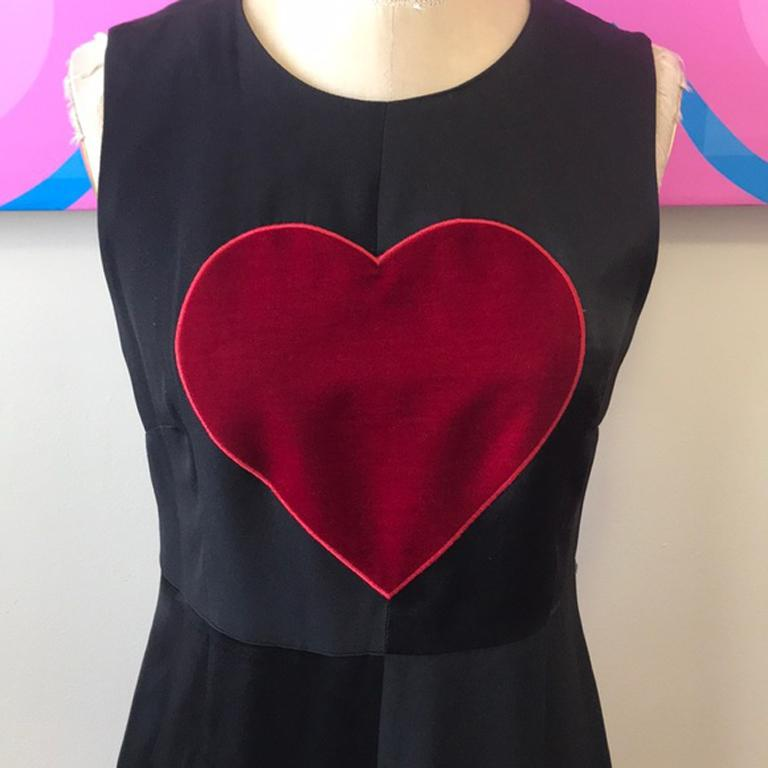 Moschino cheap chic black satin red heart dress  Iconic Moschino satin dress with red velvet heart design. Fit and flare design . As wearable today as when it was made, vintage 1990s. Brand runs small.  Size 6  Across chest - 17 inches laying
