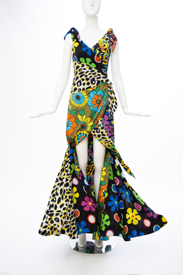Moschino Couture, Jeremy Scott, Runway (Look 12) silk multi printed high-low evening dress with concealed side zip closure and fully lined.  It. 38, D. 34, FR. 34, GB. 6, US.4  Bust: 30, Waist: 24, Hip: 34, Length: 60  Fabric: 100% Silk; Lining 100%
