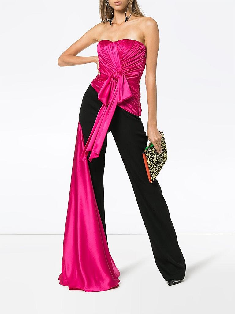 Moschino Couture jumpsuit specially designed with dramatic exciting eye catching presence!  Ruched rich rose magenta silk bodice with  fine black wool tux style trousers. Boned bodice with interior bra. Side zipper closure.  Single hip pocket; with