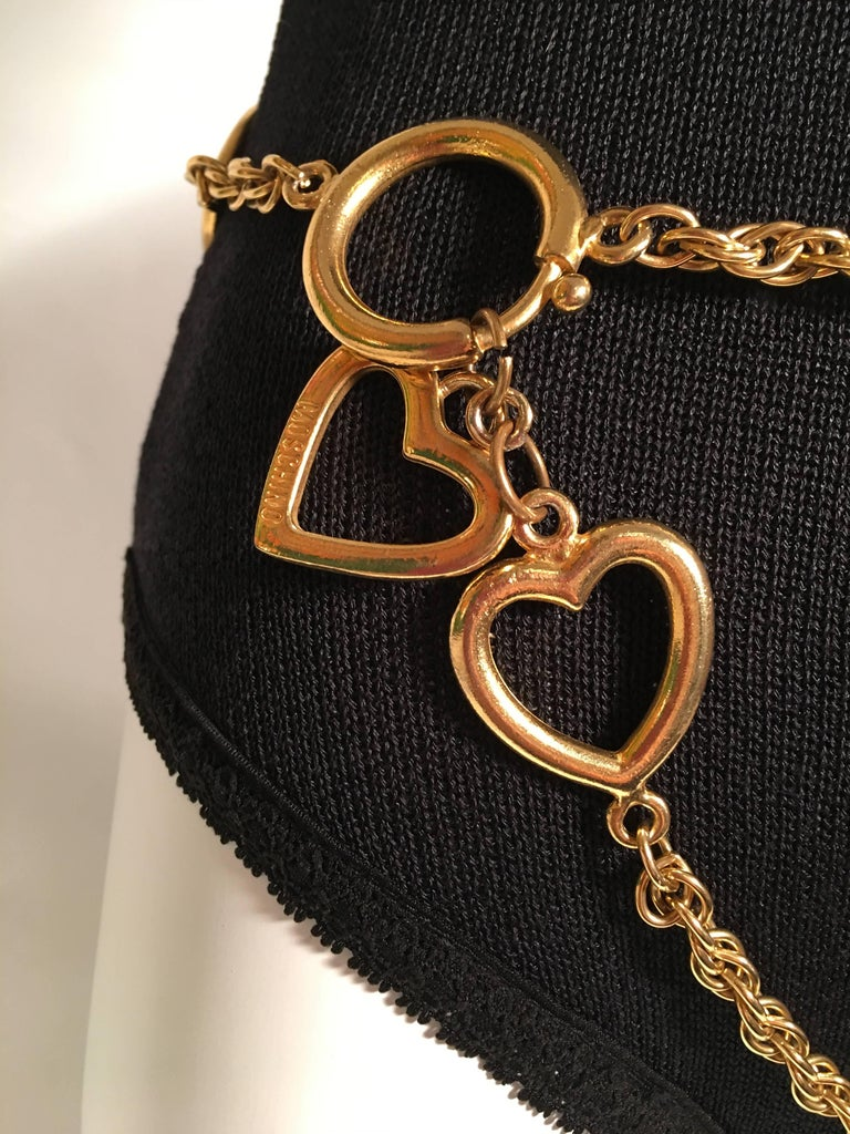 Moschino Gold Charm Chain Belt with heart and peace sign detail.  *MEASUREMENTS TAKEN FLAT* Total Length: 44
