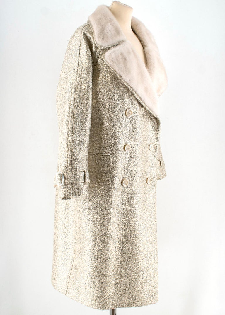 Moschino Gold Metallic Wool blend Coat with Fur Collar   - wool blend golden tone coat - embellished with white mink collar - lined - double breasted  - button fastening to the front  - buckle embellishment to the front  Please note, these items are