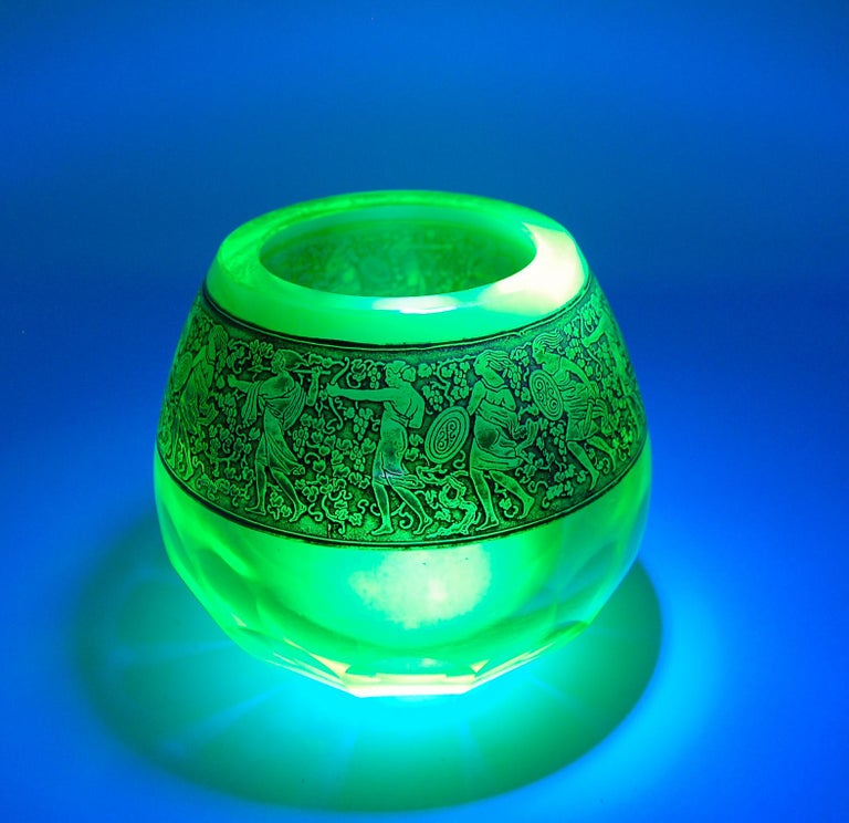 This (uranium) Vaseline glass vase features Moser's Warrior Frieze decoration. Produced and designed in the former mecca of glass, Czechoslovakia, by Moser, this line is sought out for its timeless design appeal. This piece will certainly add to any