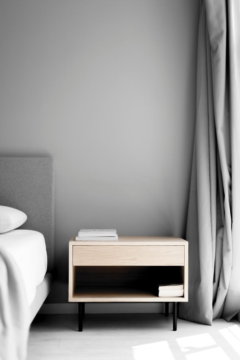 Bed table with drawer, cover and shelve in white oak veneer on steel structure in electrostatic paint.