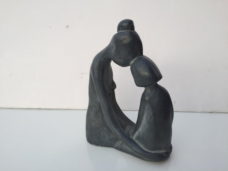 Small signed sculpture in grayish blue.
