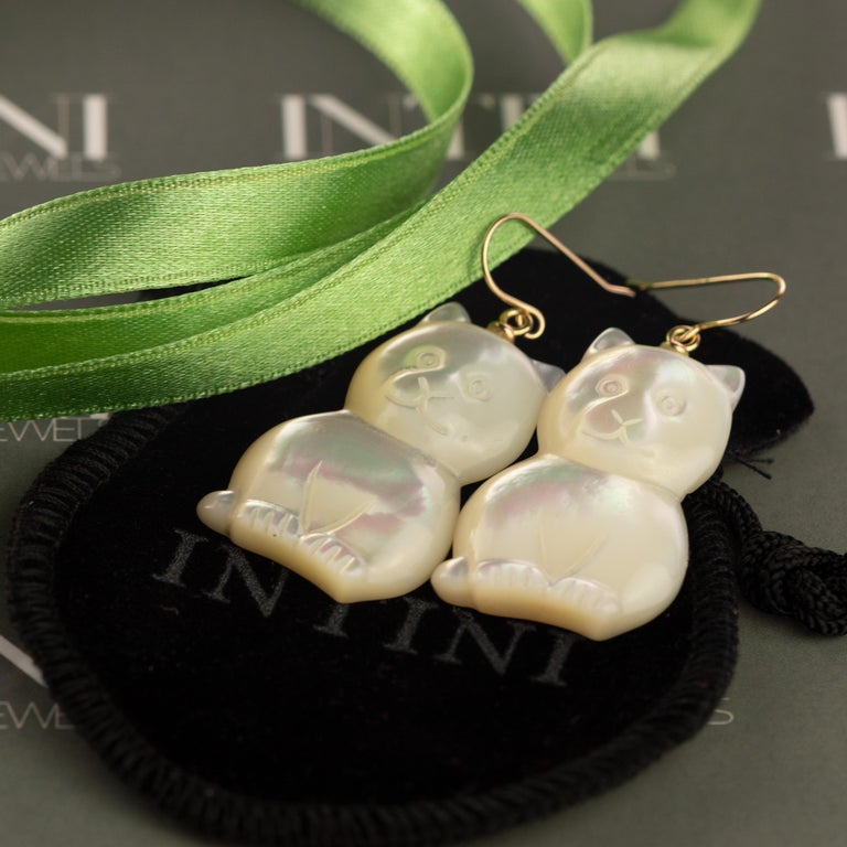 Stunning unique piece. Mother of pearl earrings with an amazing cat, feline or animal shaped form. Marvelous jewel with 18 karat yellow gold setting. Drop, chic and handmade earrings  Mother of Pearl brings the gentle healing power of the sea. It is