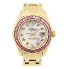 Mother of Pearl Diamond Dial Sapphire Bezel Watch