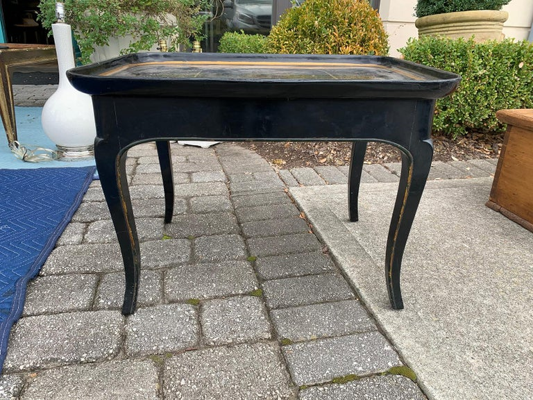 Mother of pearl inlaid and painted black coffee table.