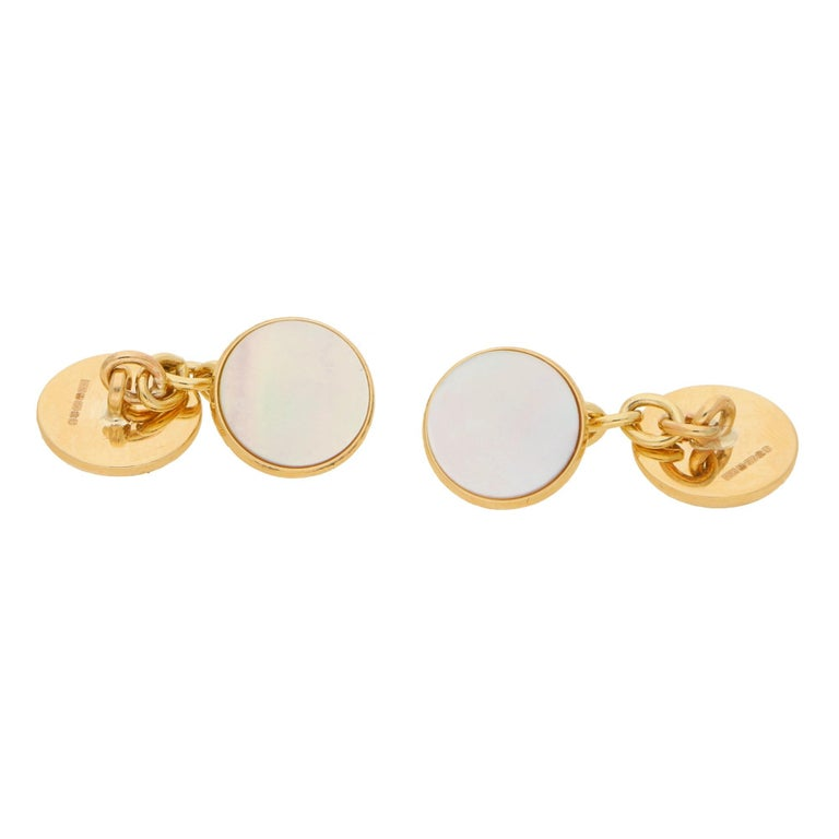 A stylish pair of mother of pearl round chain cufflinks set in 9k yellow gold.   Each cufflink solely features and single piece of lustrous white mother of pearl. The mother of pearl is set on-top of a solid 9k yellow gold disc which is connected to