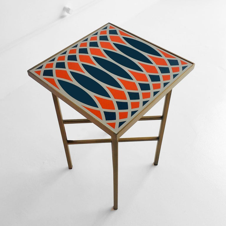 Table with Painted steel frame and inlaid saddle leather coated top.  Designed by: Analogia Project Made in Italy.
