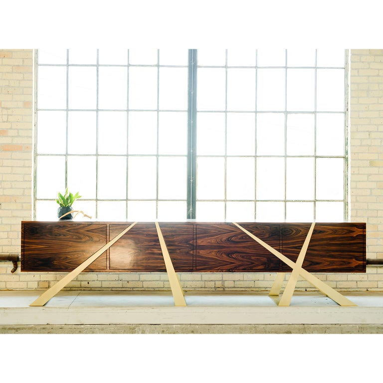 """The Mott sideboard is a stunning piece that endeavors to explore the relationship between form and function. It's been said that """"form follows function"""" but the Mott sideboard with its many compartments shows that beautiful results can be found when"""