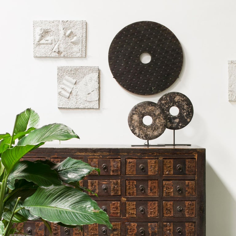 Carved Mottled Stone Bi Disc on Wall Mount For Sale