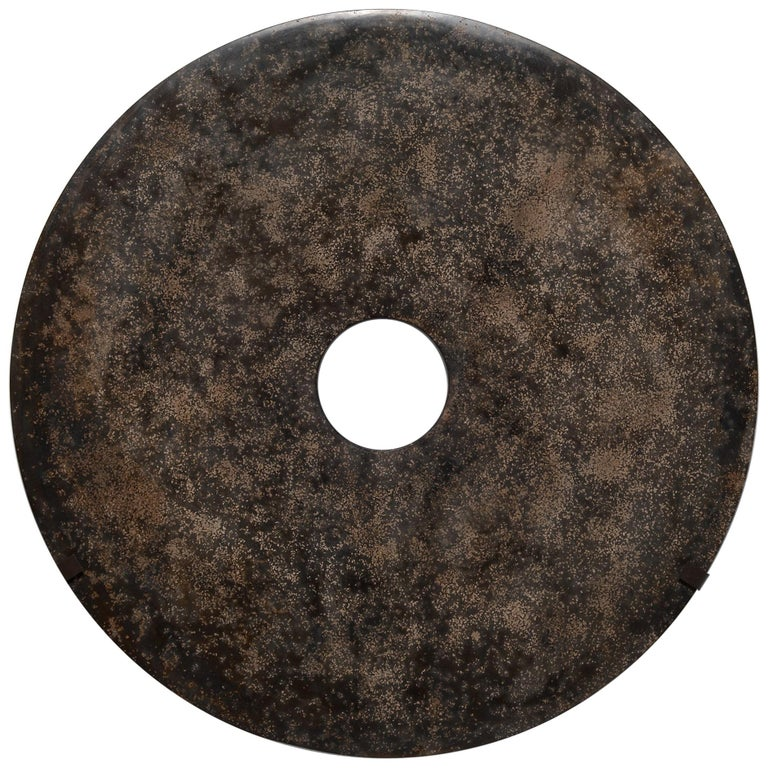 Mottled Stone Bi Disc on Wall Mount For Sale