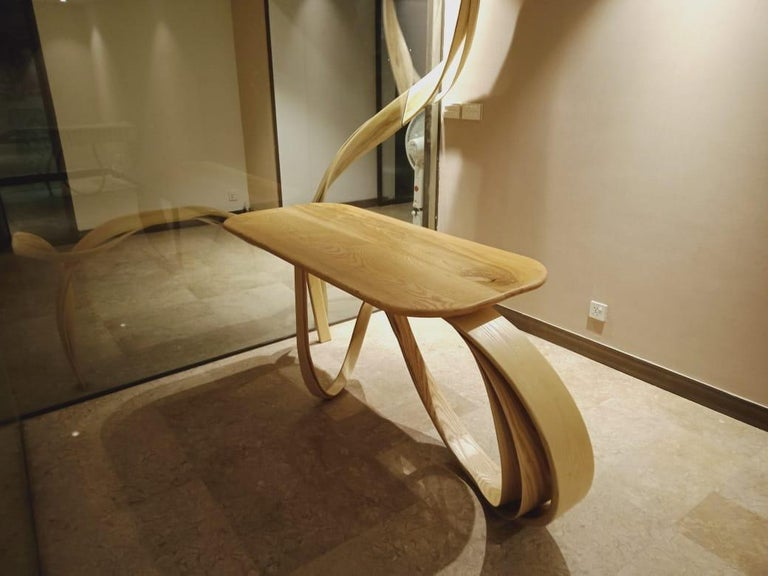 The Motus console is designed using the ancient Japanese technique of wood bending. At Raka Studio we create designs using this technique which are fluid in their form and are coherent with the laws of nature. The base design is constantly in motion