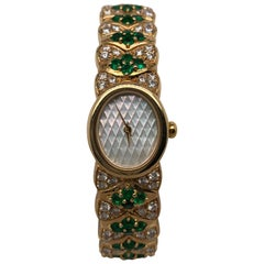 Mouboussin Emerald and Diamond Watch and Bracelet