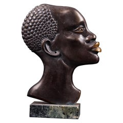 Moulded Copper Alloy Head of an African Figure with a Stone Base