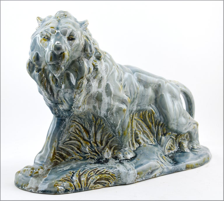 French Art Deco lion statue by Moulin-des-Loups (Orchies), France, circa 1940. Ceramic sculpture. Spectacular and unusual glaze. Measures: Height 11