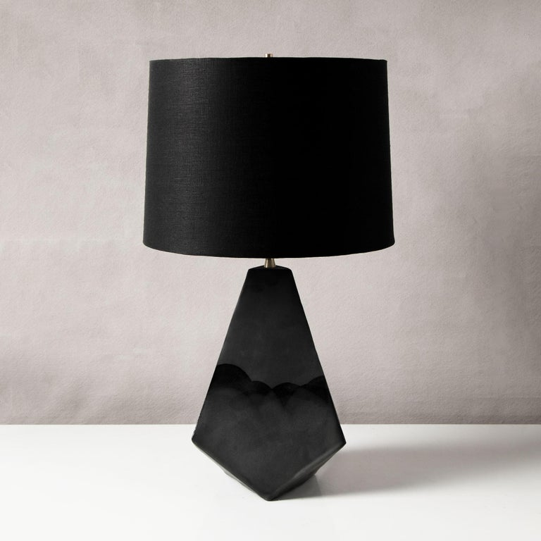 This bold geometric ceramic lamp is made from a rich red-brown clay, formed into a dramatic pyramid shape, and featuring an organic matte finish accented by hand-poured satin glaze. Each piece is individually handmade and entirely