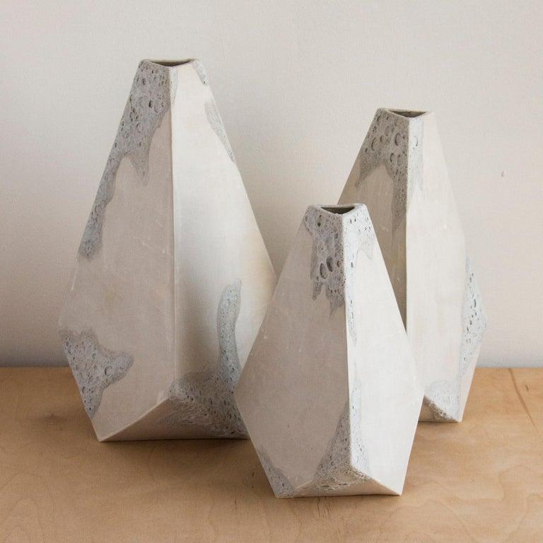 This set of 3 geometric ceramic 'Mountain' vases are made from a sandy beige clay formed into dramatic pyramid shapes. Each individually handmade piece is entirely unique, featuring an organic matte finish accented by hand painted textured white