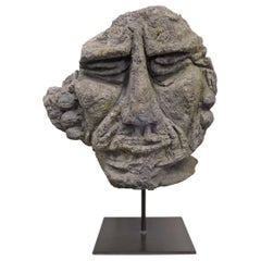 Mounted Carved Lava Stone Human Face Sculpture