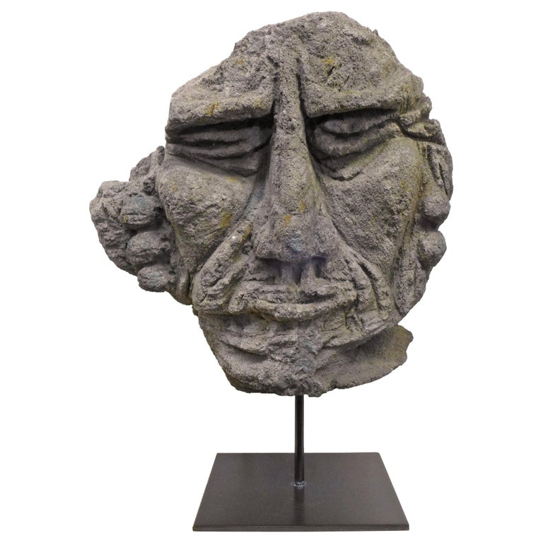 Mounted Carved Lava Stone Human Face Sculpture For Sale