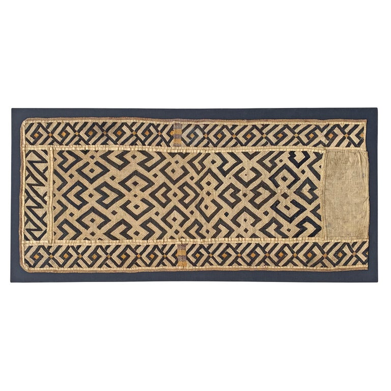 A wonderful early 20th century Kuba cloth panel with a fantastic all-over geometric pattern woven in black and natural raffia. Kuba cloths are constructed of fine strips of raffia, knotted and cut, creating beautiful geometric patterns. This piece