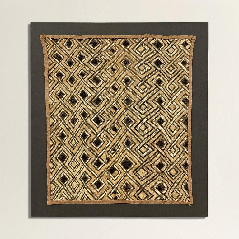 A striking 20th century Kuba cloth panel with a fantastic all-over interlocking meandering hook pattern woven in black and natural flat-weave and cut pile raffia. Kuba cloths are constructed of fine strips of raffia, knotted and cut, creating