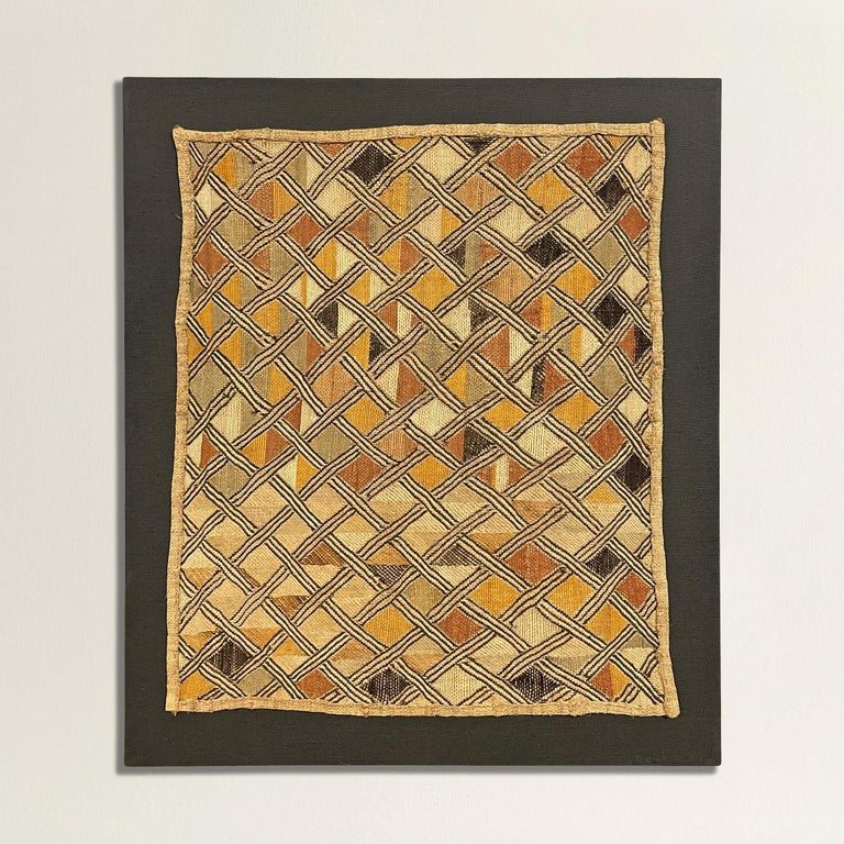 A wonderful mid-20th century Kuba Shoowa flat-weave multi-colored embroidered raffia cloth panel with a fantastic all-over geometric motif. Sometimes multiple panels are stitched together to create long dance skirts worn by men during various