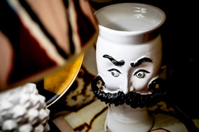 These moustached vases are handmade in Sicily and they are the contemporary representation of the 'Mori' vases.