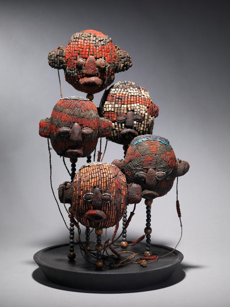 Five beaded ceremonial small trophy heads. They are inspired by the very old and rare Atwonzen beaded skulls created for Bamileke King. They originate from the kingdoms located in the Dschang region. These representations consistently portray the