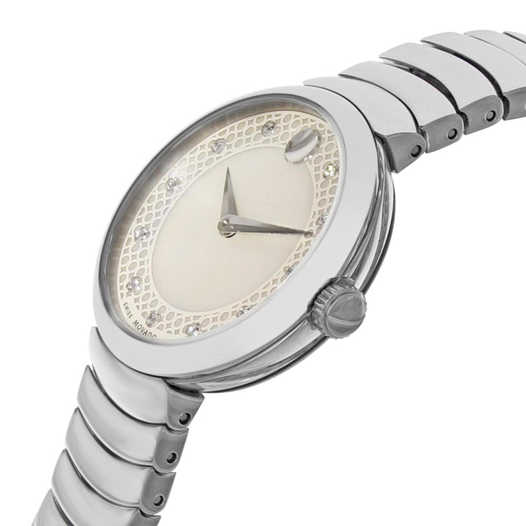 This display model Movado Myla 0607044 is a beautiful Ladies timepiece that is powered by a quartz movement which is cased in a stainless steel case. It has a round shape face, diamonds dial and has hand diamonds style markers. It is completed with