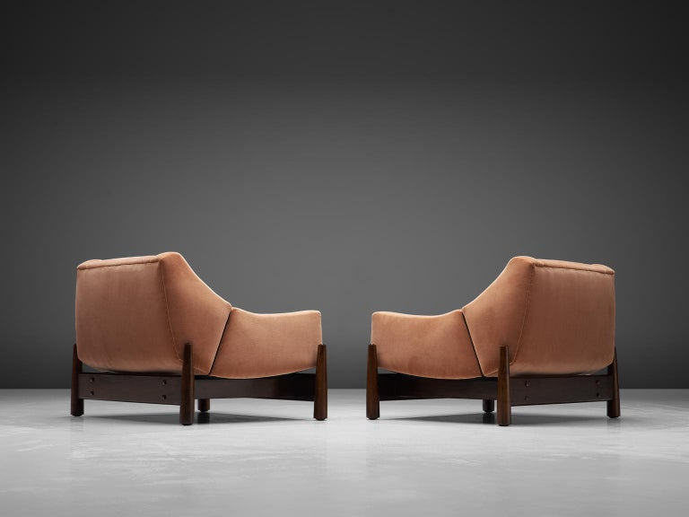 Móveis Cimo, pair of lounge chairs, rosewood and fabric, Brazil, 1950s.   Fully restored and reupholstered pair of Brazilian lounge chairs, designed by Móveis Cimo. These eye catching club chairs feature an organic shaped seat that rests on the