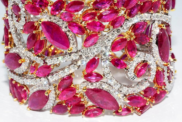 Mozambique Marquise Ruby and Round Diamond 18K 2 Tone Bracelet   Heat Only Mozambique Marquise Ruby 80.01 ct Round Diamonds 12.76 ct F VS 18K White and Yellow gold 7 Inches Long 1.75 Inches Wide