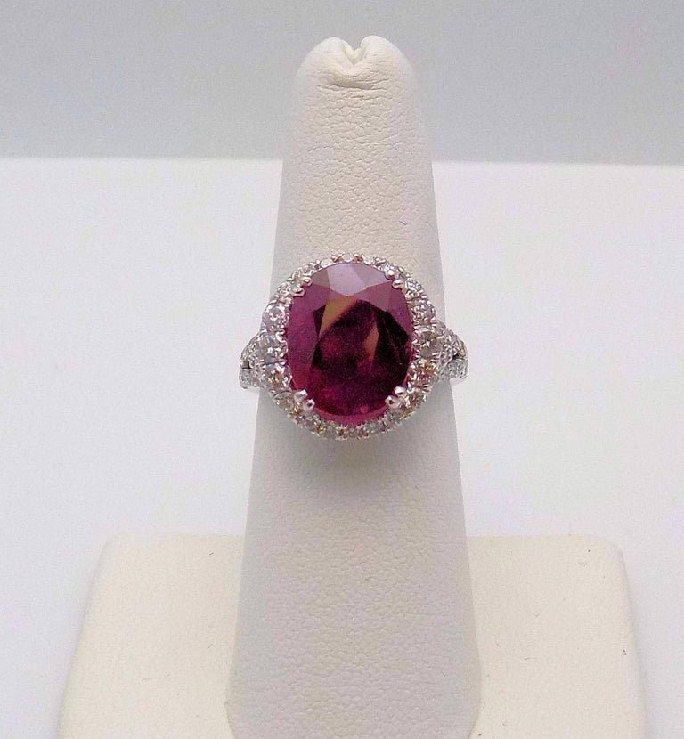 18 Karat White Gold Ring, Oval Mozambique Ruby, 6.65 Carat with GIA #6182435466, 60 Round Brilliant Diamonds 1.50 Carat Total Weight; Finger Size 7; SI, H. 4.1 DWT or 6.38 Grams.