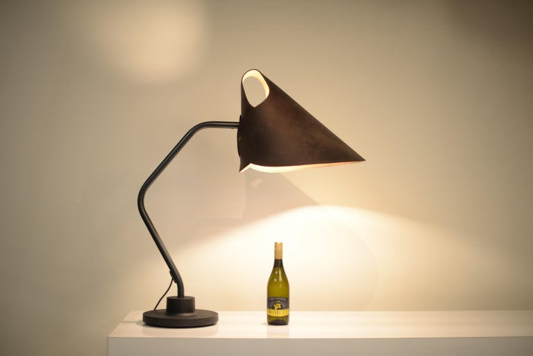 Is there any question why the mrs.Q table lamp has curled its way into the hearts of design savants the world over? This kicky creation, designed by Jacco Maris, has a fabulous folded leather shade, available in five colors, perched upon a