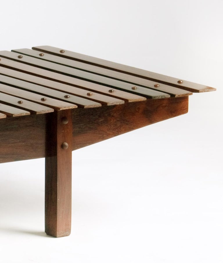 Mucki bench with solid rosewood slays and feet, structure in plywood and rosewood veneer .