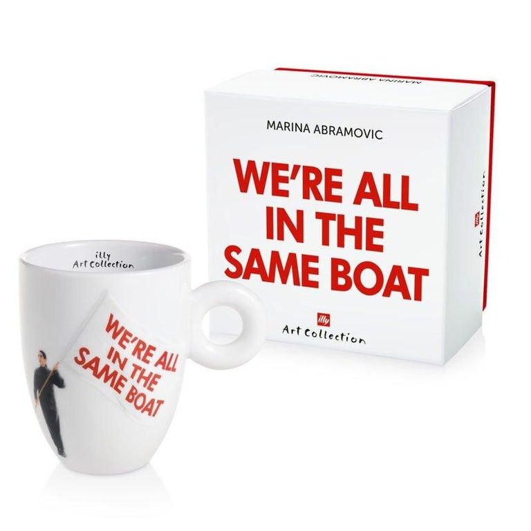 Ceramic 8.8 oz coffee / tea mug custom gift box microwave safe  This collectible mug from the incomparable Marina Abramovic celebrates our common struggle. The image shows the artist waving a flag with the words