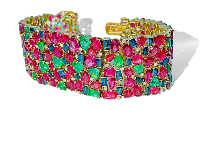 Metal: 18K yellow gold.   Gemstones: Burma ruby, Colombian emerald, and blue sapphire.  Total carat weight of gemstones: Over 200 carats.  Mixed fancy cut gemstones. All stones are 100% natural earth mined.  NO heat - NO treat gemstones.  Non