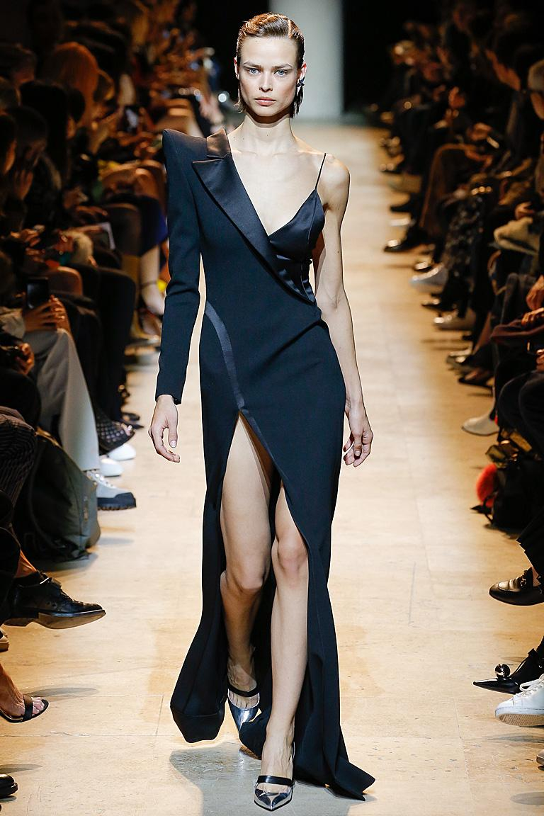 Mugler's sleek and chic tux gown is one of the most dramatic entrance making creations for this holiday.  For that special black tie event it's a must wear!  Make an entrance!  Iconic Mugler silhouette is edgy in its presentation.  Fashioned of